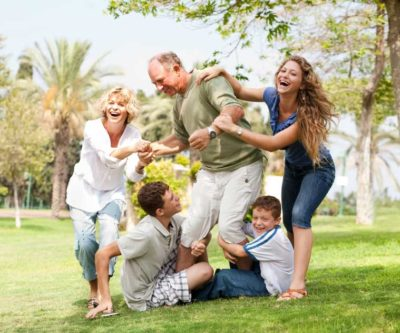 happy, healthy family enjoying outdoor time